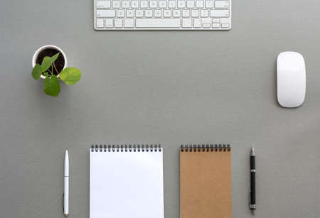 Classic Tone Wood Background Opened and Folded Beige Notepads Small Green Plant  Computer Mouse and Keyboard Top View