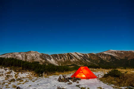 camping tent: Winter Hiking Bivouac in Mountain Landscape and Night Sky with Many Stars Red Tent and Snowy Terrain