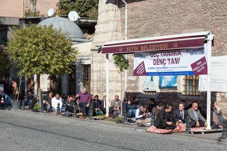 mohammedan: Modern Turkish Men sitting at Street preparing to Traditional Midday Mohammedan Prayer Ceremony. Istanbul, Turkey, November 20, 2015 Editorial