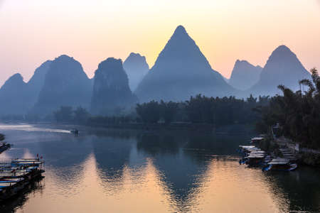 Karst Mountains and River Sunrise View at Guilin City in China Passenger Vessel floating along