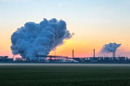 Smoke Stack from Chimney of Chemical Plant at Sunrise