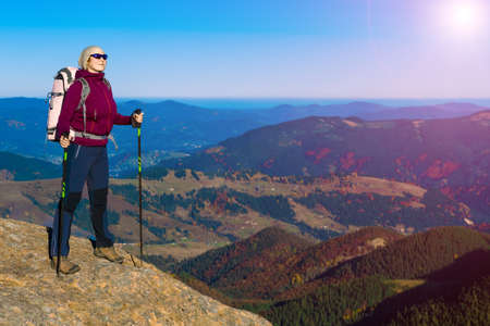 Woman hiker on a mountain viewing the scenery Stock Photo
