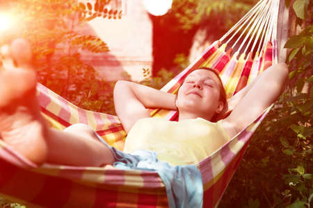 Person relaxing in Hummock at Summer Garden with Sunlight