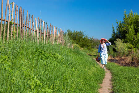 Rural Trail along wooden Fence and Person walking