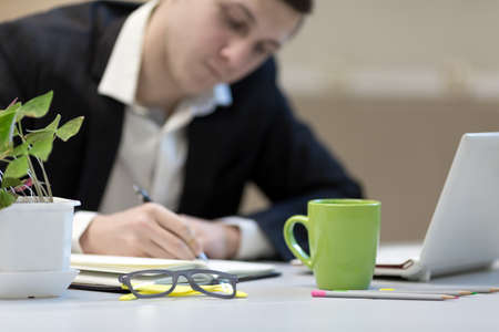 Businessman making Hand notes at Office working Place