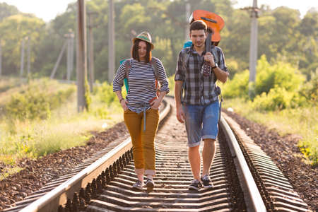 Two young Hikers walking along Railroad