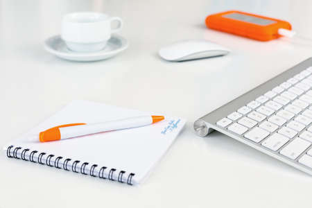 Business Composition on white Desk orange Items Stock Photo