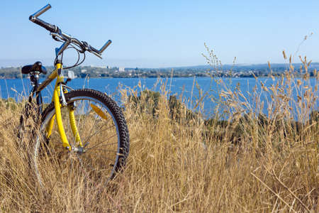 Rural View tih River and Grass and Cycle Stock Photo