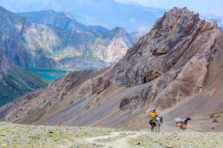 inaccessible: Majestic Mountain Landscape and cargo Donkey Caravan