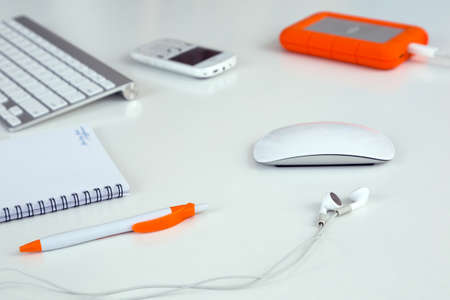 Business Composition on white Table with earphones