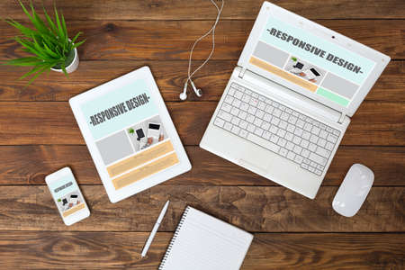 Working Place of web Designer on wood Table top View