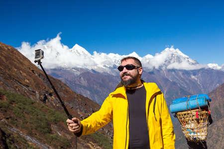 sherpa: Man taking self portrait during mountain trekking