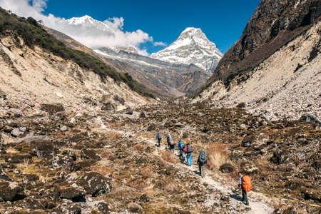 teambuilding: Hikers walking on Mountain Trail horizontal Stock Photo