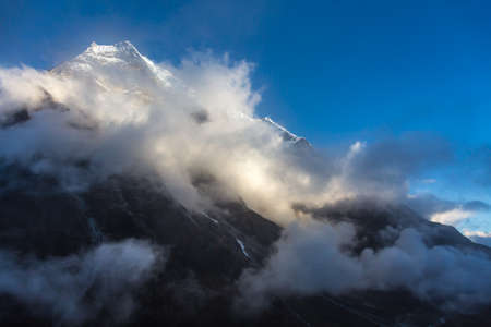 View of Mountain Peak and massive Cloud Front