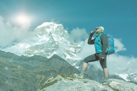 staying fit: Man drinking Refreshment in high altitude Mountains soft toned