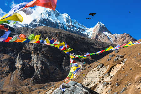 View of high Mountains and Nepalese buddhist prayer Flags