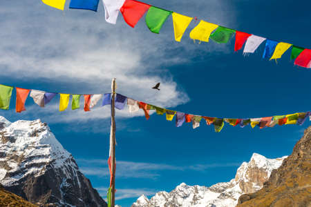 Nepalese Prayer Flags hanging in Wind in Himalaya Mountains