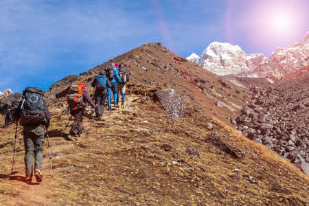 Mountaineering Expedition moving toward high Altitude Mountain Sunshine