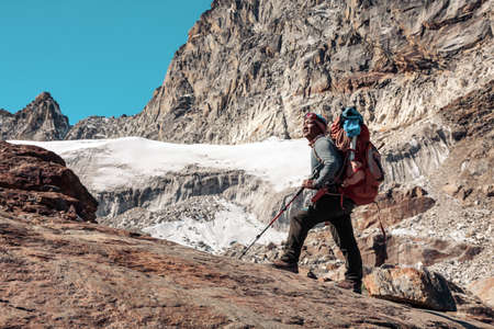 Portrait of Nepalese Mountain Guide staying on Rock and Glacier Stock Photo