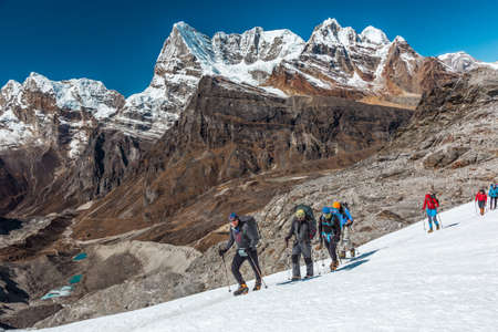 multi age: Group of People of different Age crossing Glacier in high Mountains