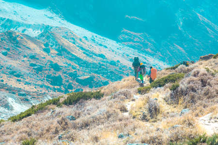 Hikers walking on Footpath in Mountain Valley trendy toned
