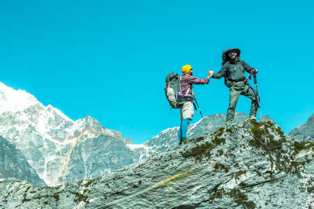 Brotherhood of People in Mountains Happy Hikers on top of Rock