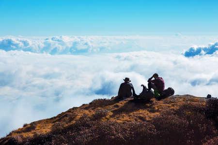 People relaxing on Mountain Cliff enjoying cloud Sky Horizon