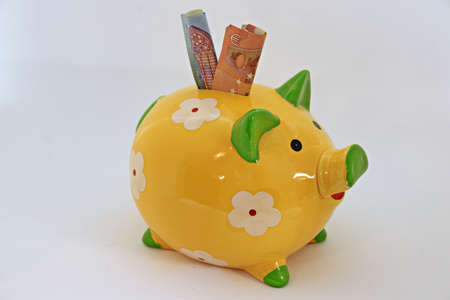 piggy bank with notes Imagens