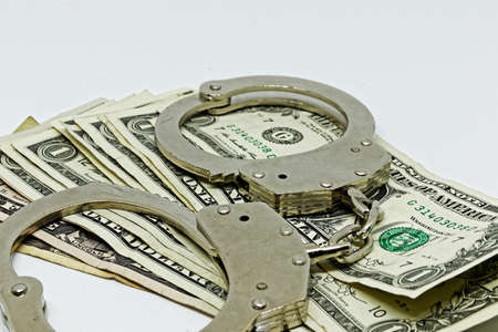 Metal handcuffs and money