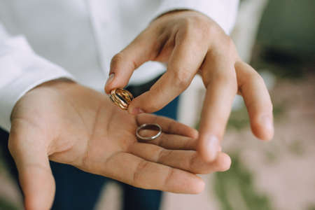 Palms Of The Newlymarried Couple With Wedding Rings In Fingers