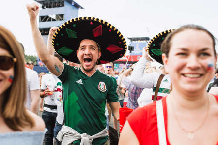 MOSCOW, RUSSIA - JUNE 2018 Happy Mexican fans in sombreros rejoice goal in the match Mexico - South Korea