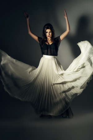 long skirt: attractive woman in flying long skirt