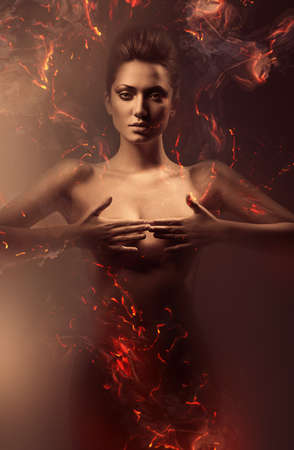 artistic nude: sensual nude woman in fire