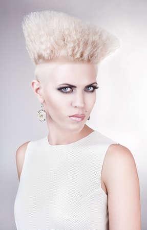 close up portrait of futuristic blond woman in white photo