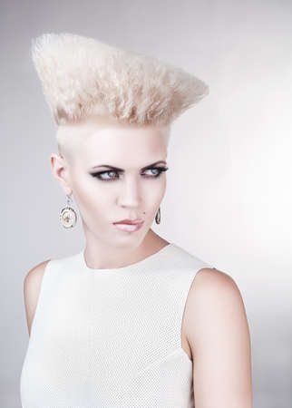 close-up portrait of creative punk blond woman photo