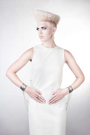 futuristic woman in dress with creative hairstyle photo