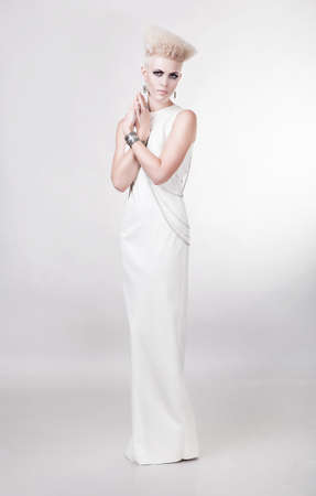attractive blond woman in long white dress photo
