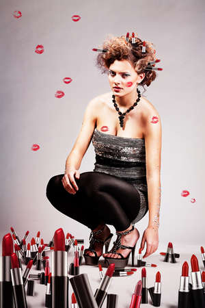 Girl with lipsticks photo