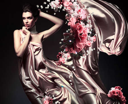 attractive woman in beautiful fabric and flowers photo