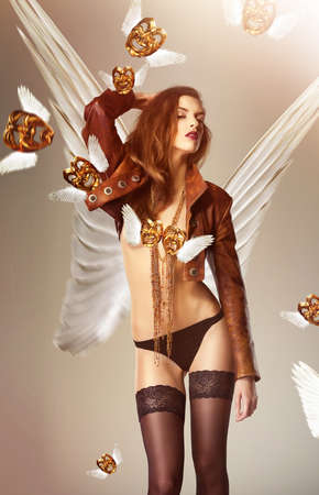 nacked: attractive woman with wings and flying venetian masks Stock Photo