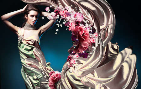 beautiful woman in long fairy dress and flowers photo