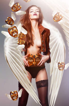 nacked: beautiful woman with wings and flying venetian masks