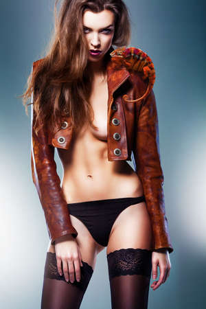 pretty beautiful erotic woman in brown jacket and panties with chameleon photo