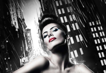 attractive brunette woman with red lips in rainy city