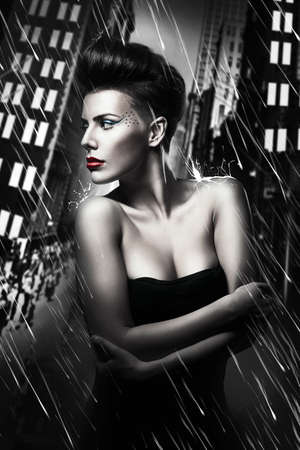 beautiful woman with red lips in rainy city photo