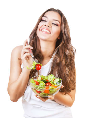 happy girl holding fork with salad on white background photo