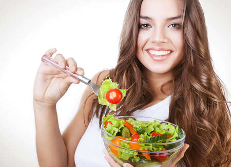 happy healthy woman with salad on fork photo