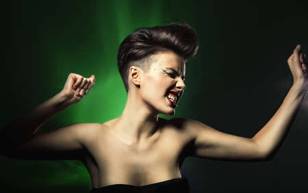 woman dancing: dancing woman with red lips in green light