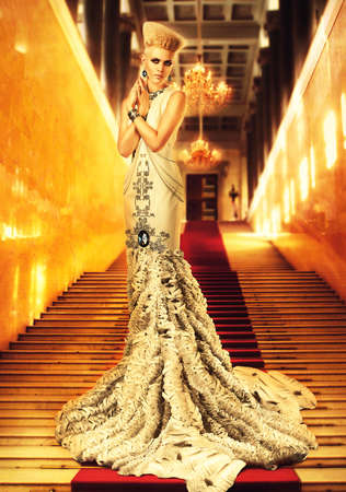 red  gold: blond woman in long white dress on red carpet