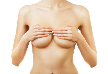 woman naked body: naked woman with hands on breasts on white background Stock Photo